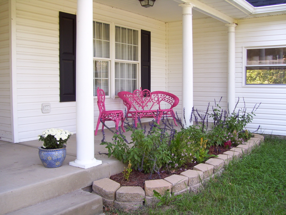 View of the painted furniture on the front porch.