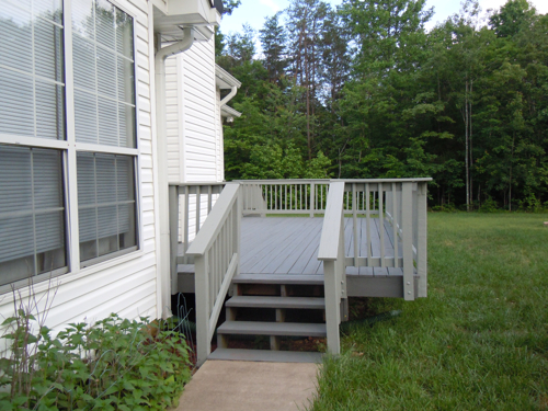 A view of the newly stained back deck from the side.