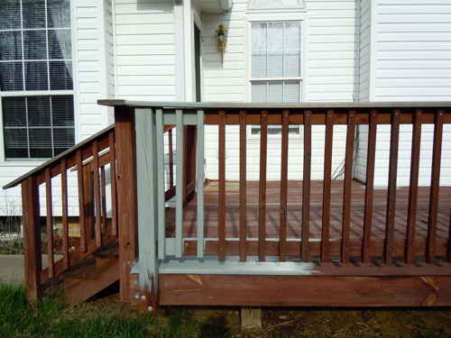 A test of the deck stain Harbor Gray by Behr.