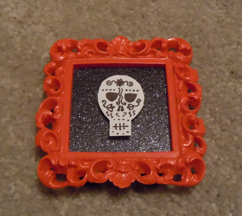 Glue skull to glitter paper