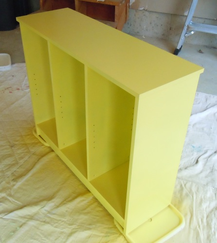 Bookshelf sprayed yellow