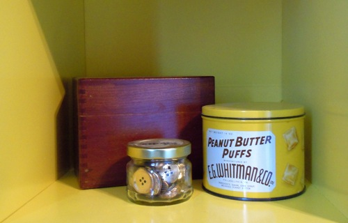 Buttons, recipe box, and antique candy tin
