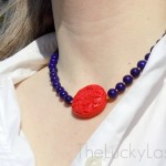 Carved cinnebar and blue glass necklace