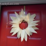 Corn husk wreath on red door