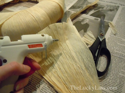 Use hot glue gun to attach husks